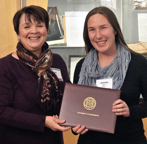 Department chair presents Ph.D. student with endowed fellowship award.