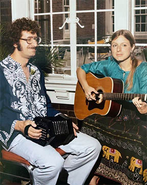 Helen Kivnick plays guitar while husband Gary Gardner accompanies her on concertina.